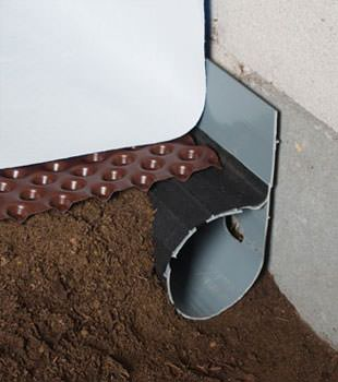 Closeup of a crawl space drainage system installed in Smethport