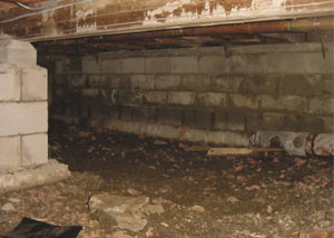 Rotting, decaying crawl space wood damaged over time in Port Allegany