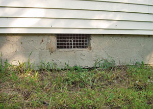 Open crawl space vents that let rodents, termites, and other pests in a home in Brookville