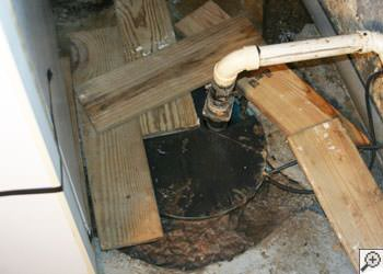 An ugly, clogged sump pump system in Saint Marys, Oil City, Franklin, Bradford, Punxsutawney, Clearfield, Clarion