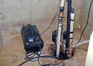 Pedestal sump pump system installed in a home in Salamanca