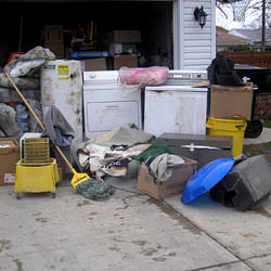 Soaked, wet personal items sitting in a driveway, including a washer and dryer in Bradford.