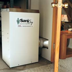 A basement dehumidifier with an ENERGY STAR® rating ducting dry air into a finished area of the basement  in Randolph